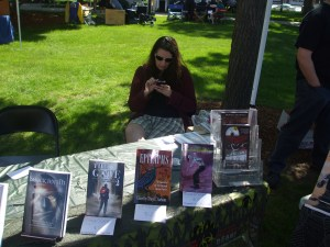 NEHW member Sarah Gomes checking her cellphone during the craft fair. Photo by Jason Harris.