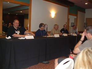 Who Was That Masked Man? panel at Necon 32. From left to right, panelists Hank Wagner, John Mcllveen, Bob Booth, and Jack Haringa.