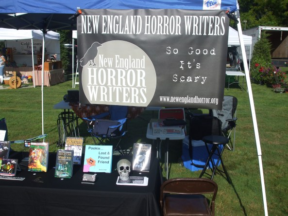 The NEHW booth at the Middletown Open Air Market and Festival. Photo by Jason Harris