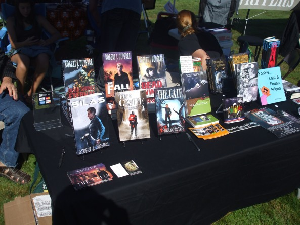 The NEHW members' books at the Open Air Market. Photo by Jason Harris.