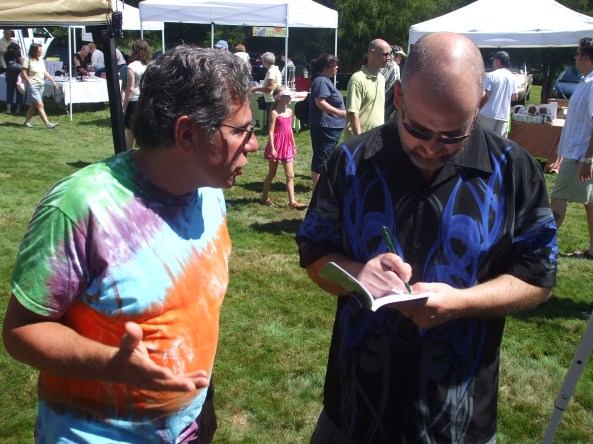 Author David Price autographing his book for a fan. Photo by Jason Harris