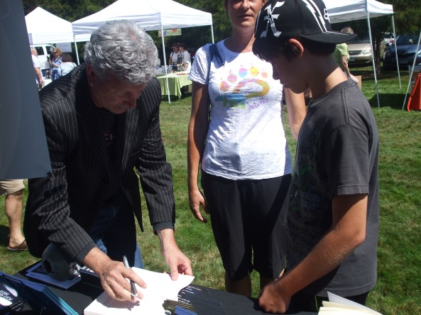 Author Alan Kessler signing his book for a young fan. Photo by Stacey Longo.