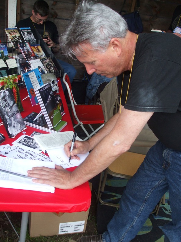 Author Alan S. Kessler signing a copy of Satan Carol. Photo by Stacey Longo