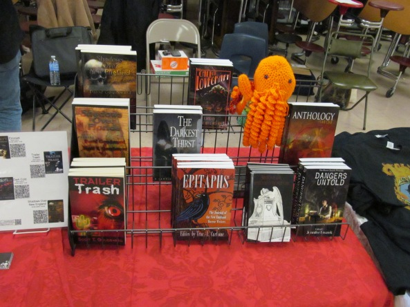 Books and a Cthulhu on the NEHW table. Photo by Jason Harris.