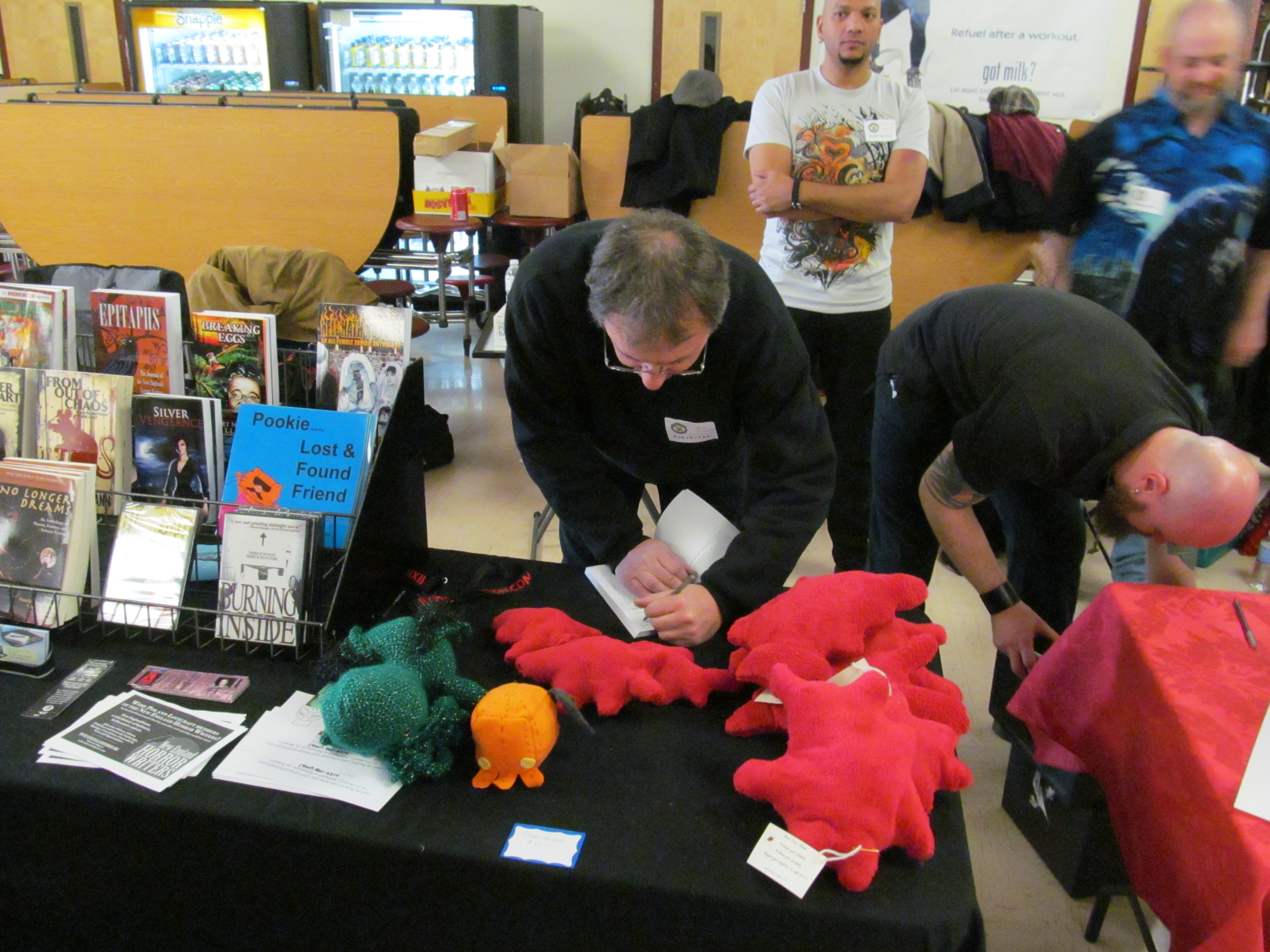 Author T.T. Zuma signing a copy of his book for a fan. Photo by Jason Harris.