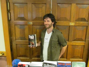 "Author and NEHW member Nicholas Conley holding his book, ""The Cage Legacy."""