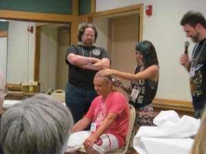 Jeannine Calia finishing shaving author Rio Youers who shaved his head for charity, The Jimmy Fund.