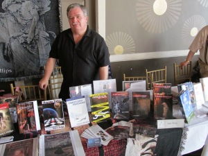 Author Dale T. Phillips behind his table.