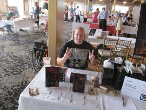 Author Vlad Vaslyn behind his table.