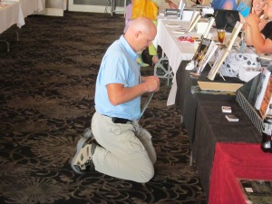 Author Rob Smales setting up his books at the New England Horror Writer table.