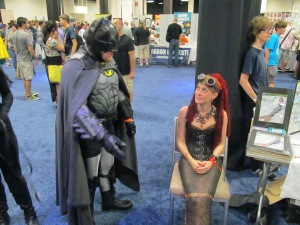 Batman talking with a mermaid.