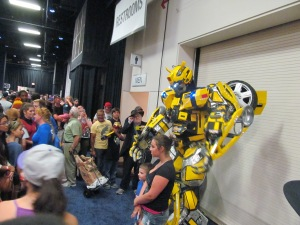 The Transformers' Bumblebee with some con attendees.