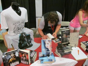 Author Estevan Bagley signing a book for a fan.