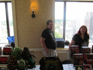 Authors David Cassenti and Laura Hickman behind the NEHW table.