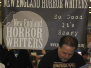 Author Scott Goudsward in front of the New England Horror Writers sign.
