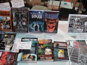 Books on the Sideshow Press table.