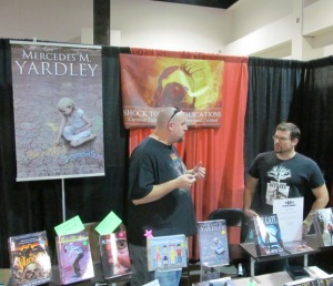 Author K. Allen Wood and artist Jessie Young behind the Shock Totem table.