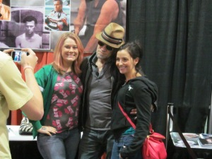 Actor Michael Rooker (The Walking Dead) with two fans.