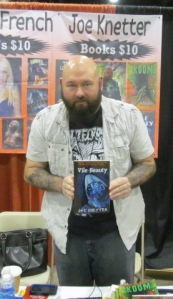 Author Joe Knetter holding Vile Beauty.