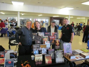 Dale T. Phillips, Stacey Longo, T.T. Zuma, and Mark Wholley behind the Books and Boos tables.