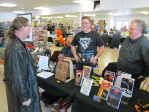Authors Gordon Bean and Dale T. Phillips talk to a visitor of the Books and Boos table.