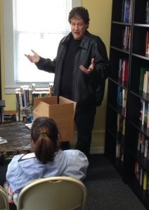 Author Mark Allen Baker talks about his book during his visit to the Colchester bookstore, Books & Boos.