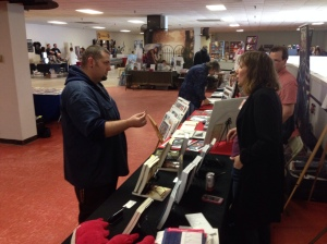 Author Stacey Longo talking with a expo attendee.