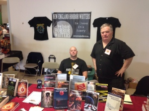 Authors Vlad Vaslyn and Dale T. Phillips behind the New England Horror Writers table.