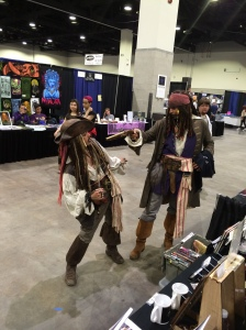 These Captain Jack Sparrows are fighting each other.