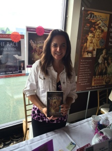 Author Gina Fava with her book, The Sculptor,