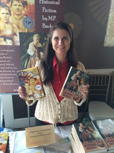 Author M.P. Barker holding her two books, A Difficult Boy and Mending Horses.