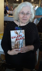 Author M. R. Tighe with her book, Galaxy Rand.