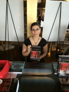 Author Katherine Silva with her book, Aequitas.
