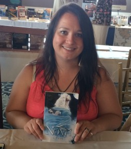 Author A.J. Kane with her first novel, Nova.