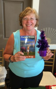 Author Ursula Wong with her book, Purple Trees.