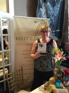Author Kelly Ilebode with her book, Angel.