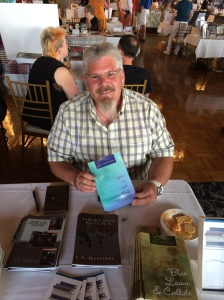 Author L.E. Hastings with his book, You, Me and Everything In Between.