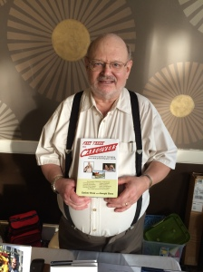 Author Joseph Ross holding his book, Fast Track for Caregivers.