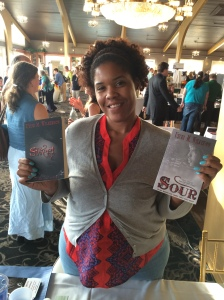 Author Uzuri M. Wilkerson with her two books, Sweet and Sour.