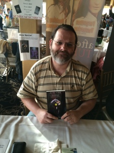 Author Rich Feitelberg with his book, Aure the Topaz.