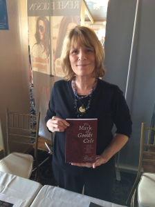 Author Cheryl Lassiter with her book, The Mark of Goody Cole.