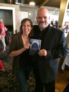 Authors Stacey Longo and T. Stephens holding Stephens' book, Dante;s Cypher.