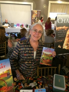 Author Edith Maxwell with her book, 'Til Dirt Do Us Part.