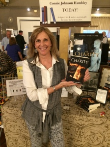 Author Connie Johnson Hambley with her book, The Charity.