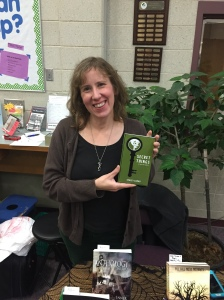 Author Stacey Longo holding her book, Secret Things.