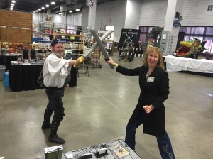 Author Stacey Longo dueling with one of the New England Brethren of Pirates.