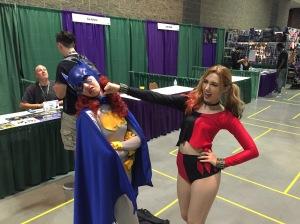 Harley Quinn punching Batgirl.