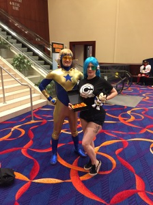 Booster Gold and a friend from the Capsule Corp.