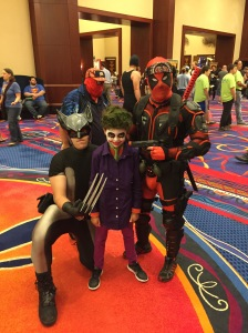 Wolverine, Joker, and Deadpool with Spiderman photo-bombing in the background.