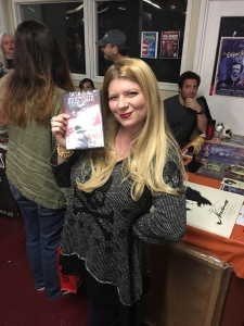 "Writer/Director Izzy Lee holding her short film, ""Innsmouth."""